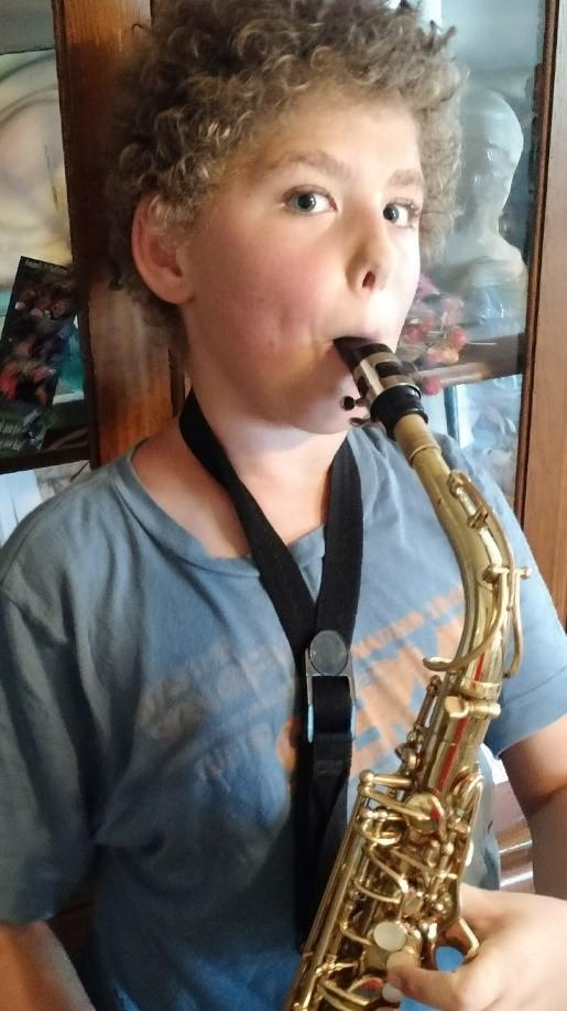 He brought home the alto saxophone.  I was so pleased. So proud. My sweet, sweet boy, growing and mellowing into himself. I stood staring with joy, and gentleness, in reverence.