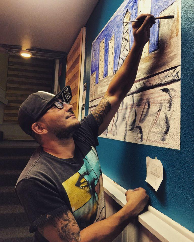 Amarillo artist Jacob Morin puts the finishing touches on one of his pieces.