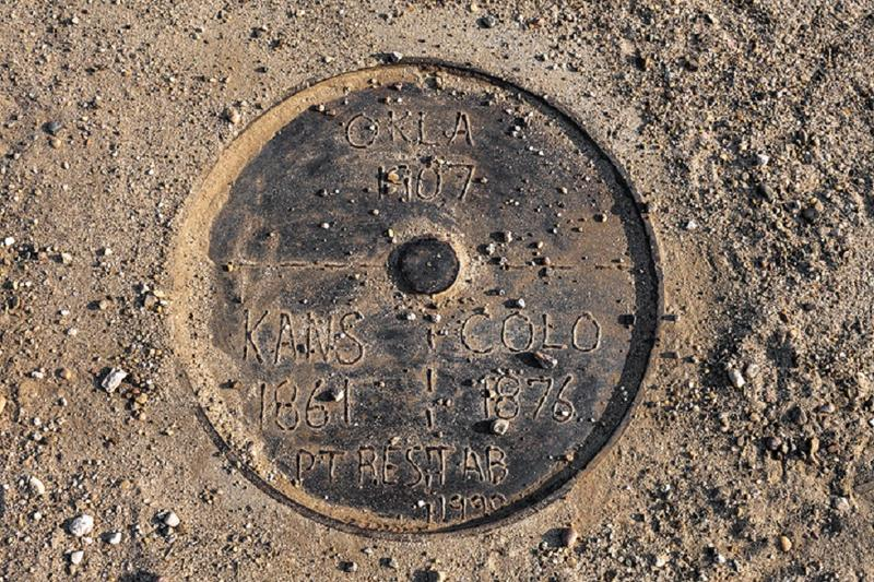 	A fancy manhole cover marks the spot in the road where Colorado's southeast corner meets Kansas and Oklahoma.