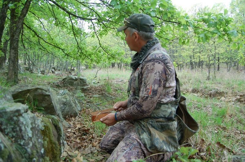 Travis Benes, manager of the Choctaw Hunting Lodge, setting up to call wild turkeys.