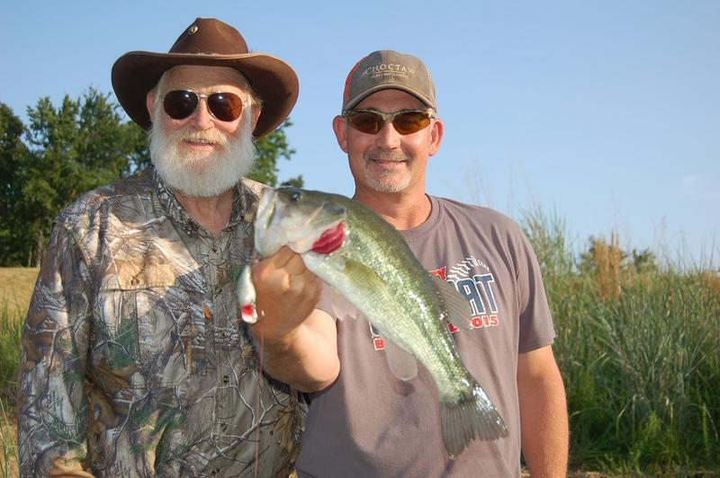 "Larry Weishuhn, aka ""Mr. Whitetail,"" left, and Travis Benes, manager of the Choctaw Hunting Lodge with a chunky bass."
