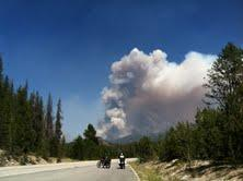 Cyclists watch smoke from the Halstead Fire.