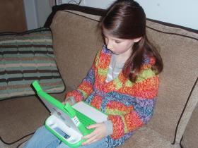 Girl using laptop for kids