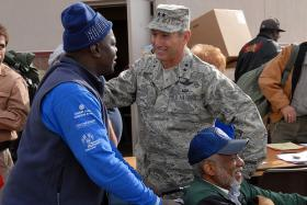 Maj. Gen. H. Michael Edwards speaks with a veteran during the 19th Annual Homeless Veterans Stand Down held at the Colorado National Guard armory in Denver Nov. 5, 2009.