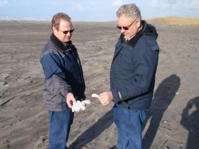 Chuck Matthews (left) and Curt Hart of WA Dept. of Ecology consult about flotsam that -- like most found on Long Beach – is impossible to trace to a specific origin
