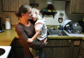 Jennie McCormack of Pocatello, Idaho, comforts her youngest son. McCormack was charged under Idaho law for having an illegal abortion