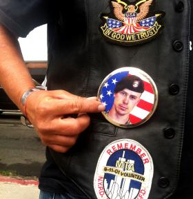A member of a POW support group shows off her Bowe button.