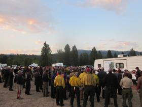 Wildland firefighters get a morning briefing at the Pine Creek Fire in the Boise National Forest.