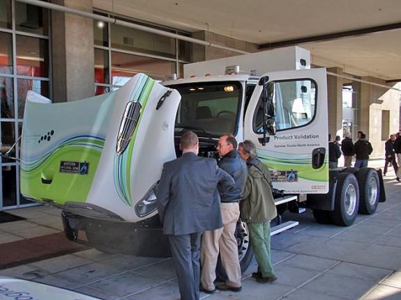 Freightliner demonstrated a natural gas fueled semi-tractor. The fuel tank is the tall, rectangular box behind the cab.