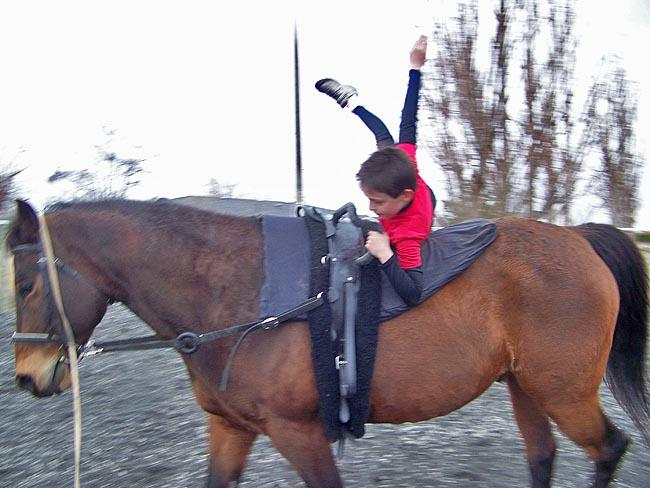 Seth Rouhier, 9, shows off his vaulting moves aboard Mo the Quarter horse in Moses Lake, Wash.