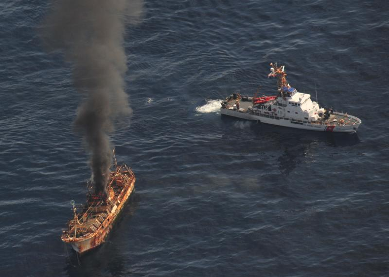 The Japanese fishing vessel Ryou-Un Maru burns after the Coast Guard Cutter Anacapa crew fired explosive ammunition at the vessel 180 miles west of the Southeast Alaskan coast