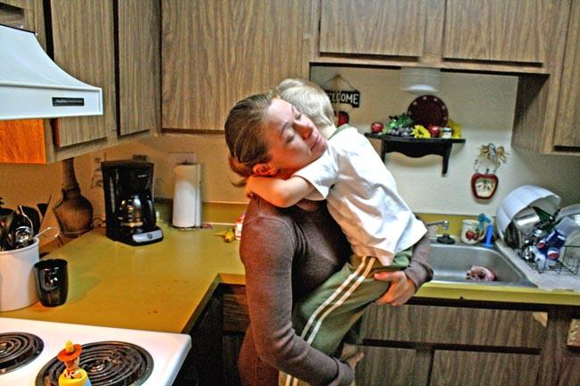 Jennie McCormack tries to calm her 3-year-old son, the youngest of her three kids.