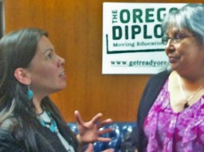 Se-ah-dom Edmo (left) with the Oregon Indian Education Association talks with Oregon Board of Education chair Brenda Frank after the board voted to ban Native American-themed mascots in Oregon schools.