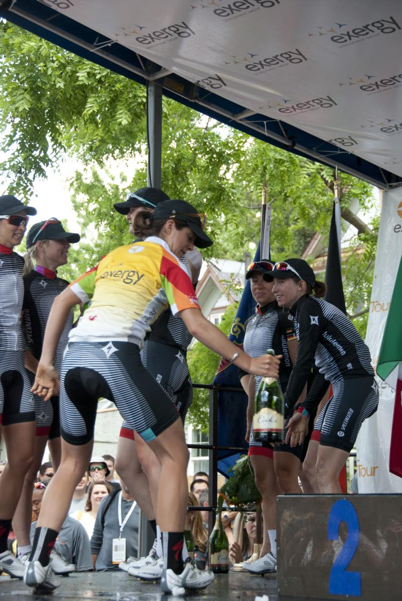 Team Specialized-lululemon celebrates by spraying each other with champagne.