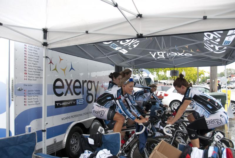 Several women warm up on trainers before Saturday's time trial in Kuna. It rained for the entire event.