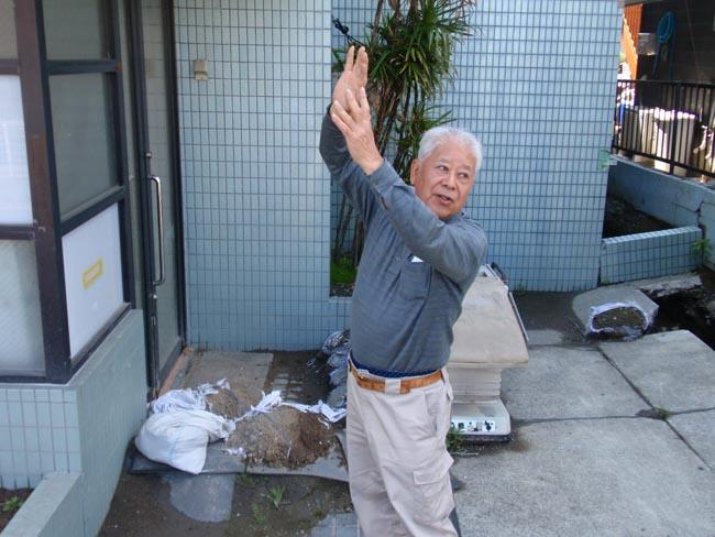 Urayasu, Japan homeowner Toru Kawahara describes damage caused by the March 2011 earthquake