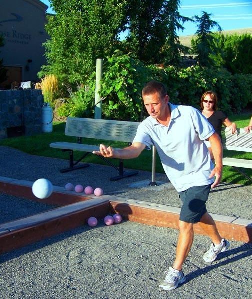 Bob Fussner, 52, of Richland, tries to pull ahead of the competing team with a careful throw at the bocce courts at Goose Ridge winery in southeast Washington.