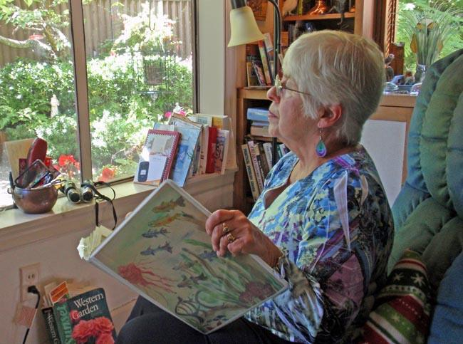 Joan Rupp of Tacoma counts and records bird sightings outside her living room window as part of Project FeederWatch
