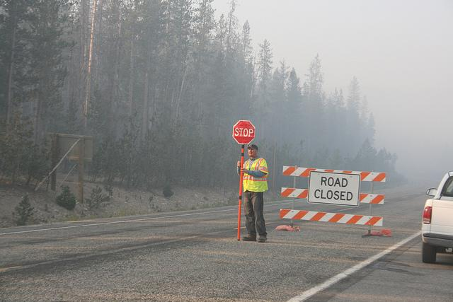 Cars are stopped and asked to wait for a pilot car to lead them through Banner Summit on Highway 21. Officials urge drivers to be careful while traveling along these roads as there is heavy fire traffic and low visibility at times from the smoke.