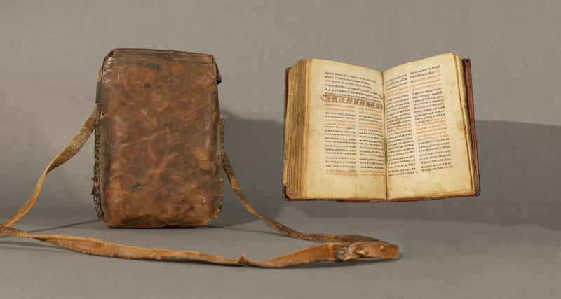Leather carrying case and manuscript Bible from Ethiopia, in the Ge'ez language. C. 18th century.