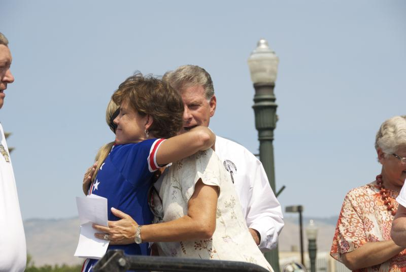 Kristin Armstrong gives First Lady Lori Otter a hug after the Governor delivers a proclamation.