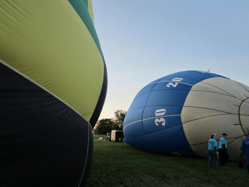 Inflating the balloons takes around 20 minutes.  First they are filled with cold air from fans, and then warm air from the burners.