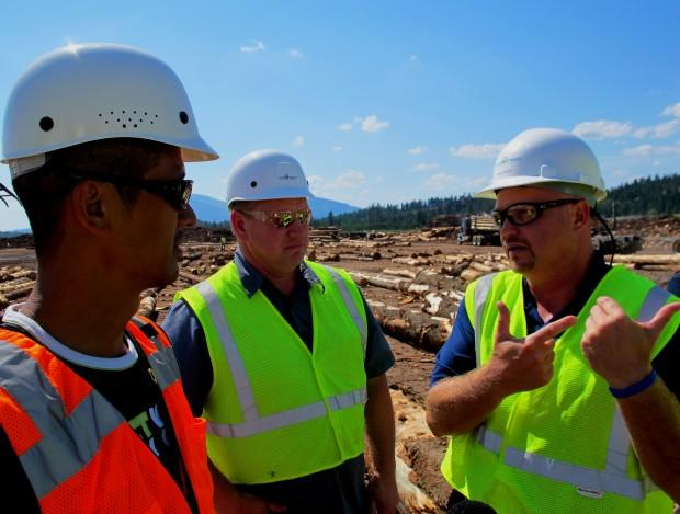 Idaho Forest Group's Mike Henley tells buyer Koji Fujiwara and consultant Paul Owen how the company sorts timber for the Japanese market.