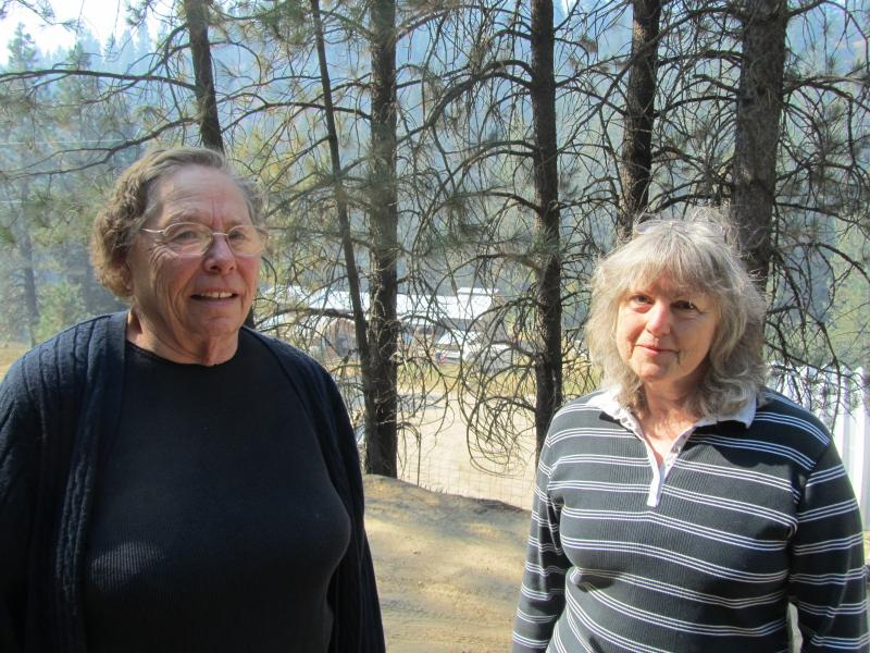 Bess Butner and Darlene Owen waited Tuesday afternoon to hear if they should evacuate their homes.