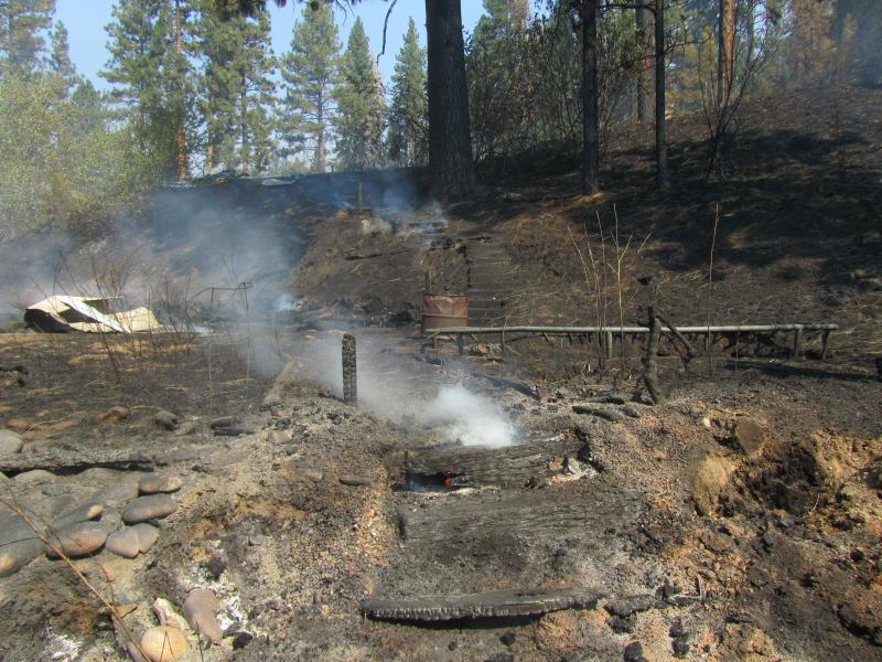 These still burning steps lead up the hill from the outbuilding to the burned home.