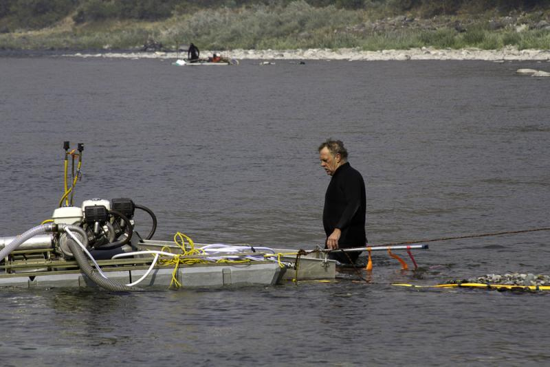 Rick Eddy does some work on his dredge before heading underwater.