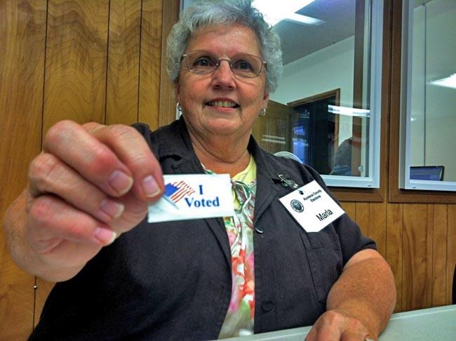 "Early voters in Idaho still get ""I voted"" stickers, as shown by Kootenai County elections worker Marla Lewis."