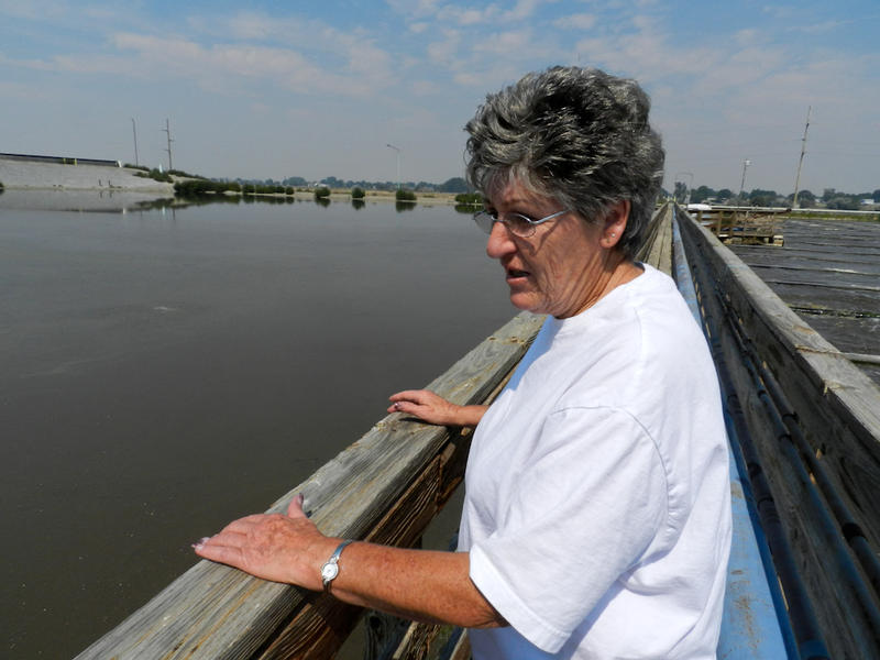 Mary Lou Herbert shows us around the old industrial wastewater treatment plant. It's old and starting to fall apart.