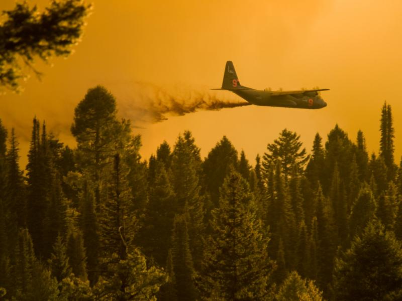A plane makes a drop on the Springs Fire.