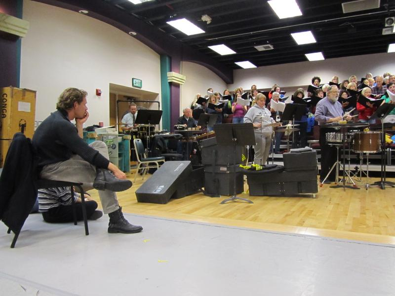 """Ballet Idaho master Alex Ossadnik watches members of the Boise Philharmonic and the Boise Master Chorale rehearse """"Sacred Land"""" this week."""