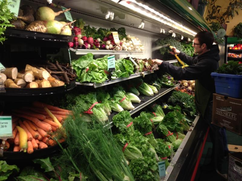 Doug Bolles works in the produce department at the Boise Co-op. The Co-op has been preparing for competition with Whole Foods.