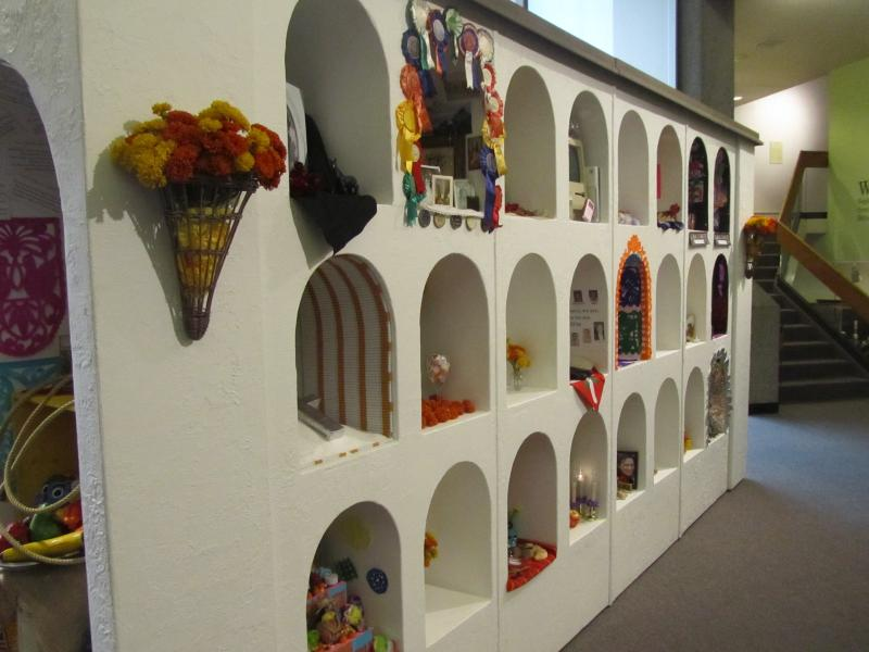 The Community Wall of Offerings is on display at the Idaho Historical Museum. It's modeled after traditional Dia De Los Muertos altars, with some modern twists. Students and artists from Boise contributed to the wall with 48 miniature altars.