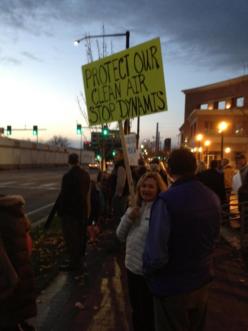 Protesters against the Dynamis Project held signs in front of the Ada County Courthouse before the public meeting.