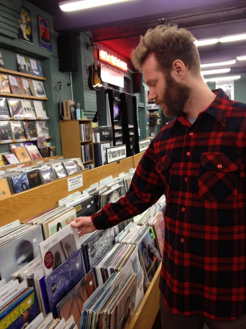 Brion Rushton thumbs through Built to Spills vinyl at the Record Exchange. He has seen Built to Spill play at least 20 times, many of those times for free.