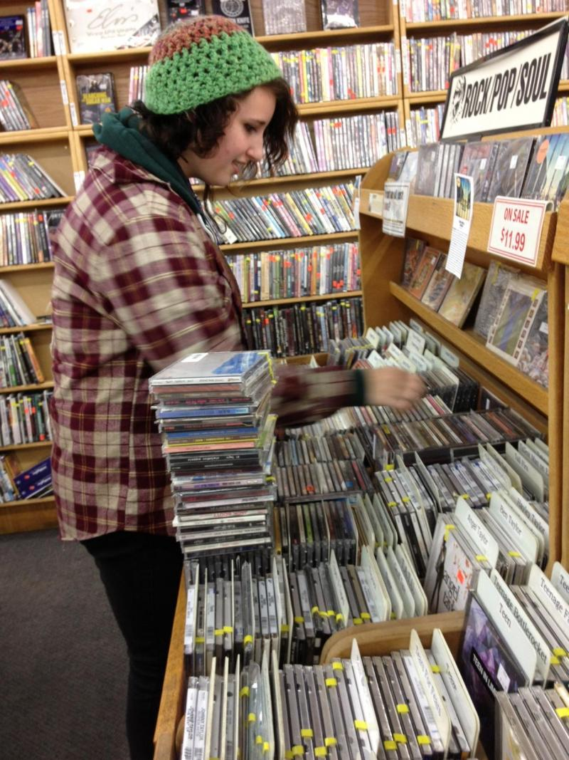 Boise High student Hannah Ponder works at the Record Exchange after school. She has grown up listening to Boise's famous rock band.