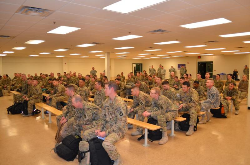 Idaho National Guard soldiers receive briefing as they return to the U.S. after nine months in Afghanistan.