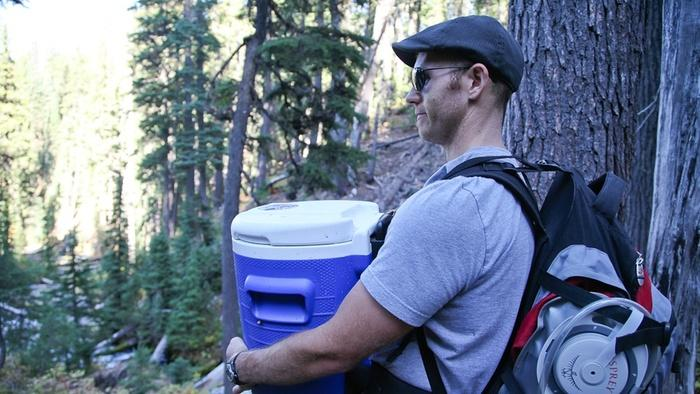 Steven Wyatt carries a 5 gallon cooler full of spring water from Boundary Springs. Wyatt enjoys brewing with spring water.