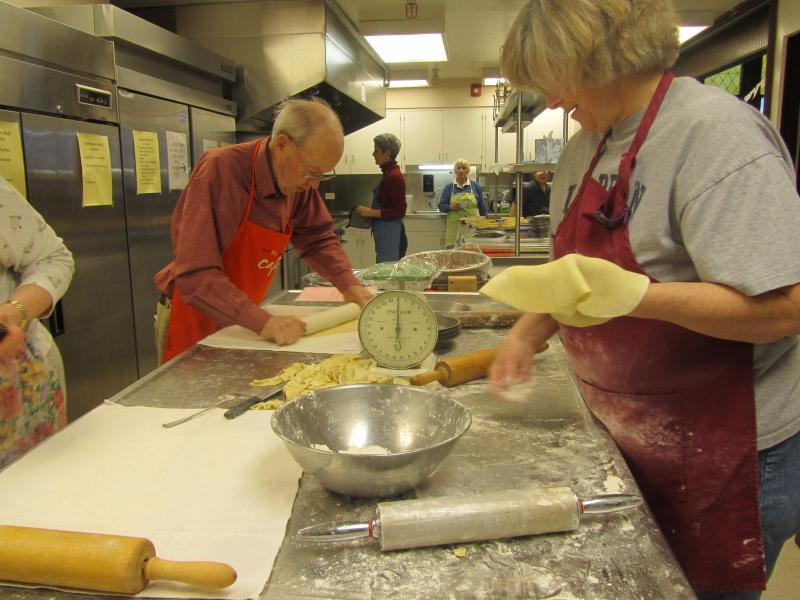 Alan Terrill and Lois Boulware roll out pie crusts in the Tuttle House kitchen