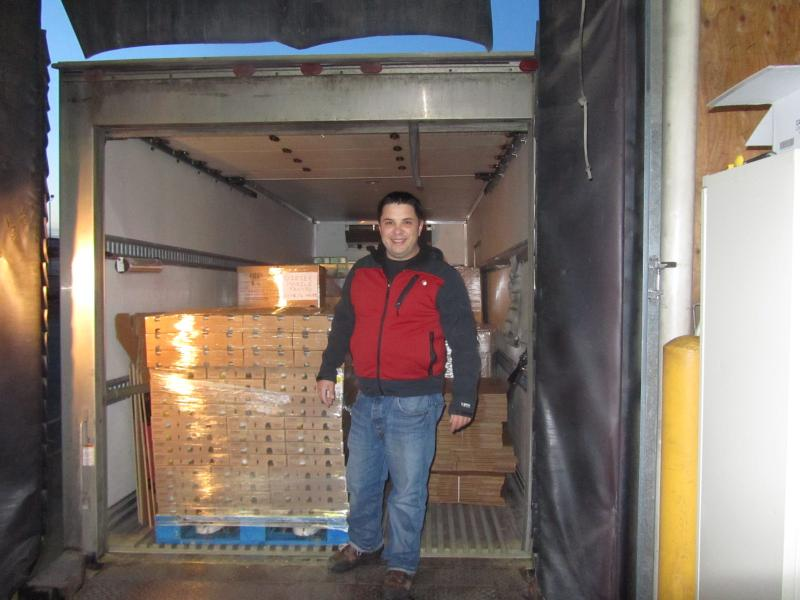 The Idaho Foodbank's Chico McKinney loads 8,000 pounds of food into the truck headed for Weiser.