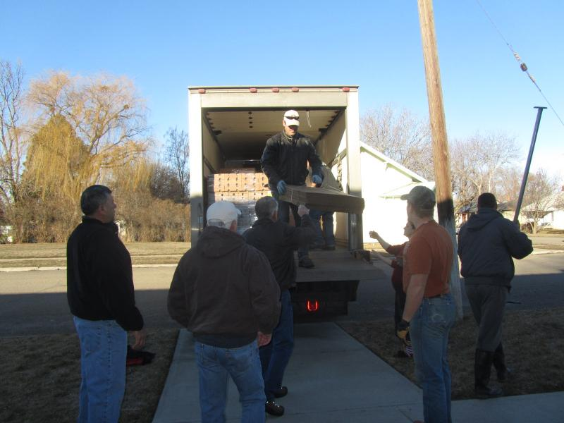 Volunteers help unload the truck at the Cornerstone Assembly of God Church in Weiser.