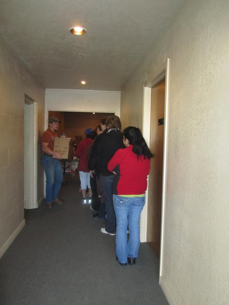 A line for the food boxes forms inside the church.