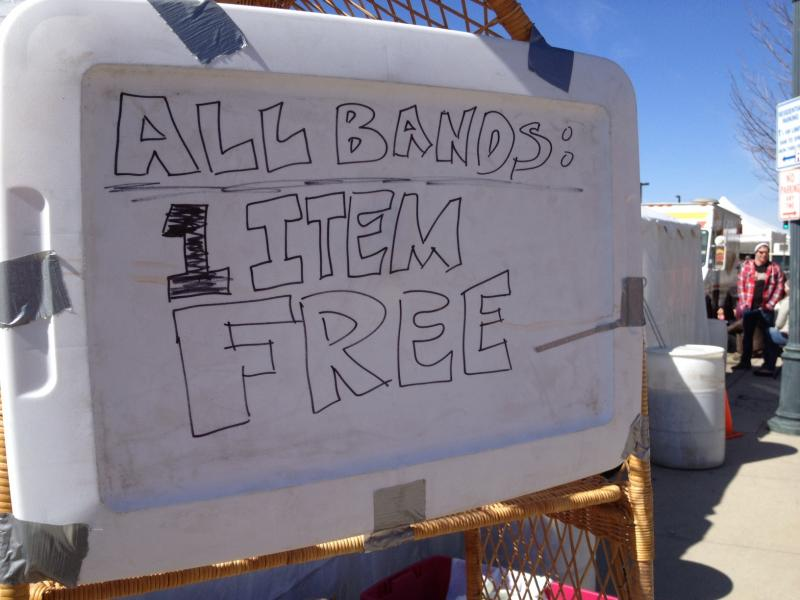 Vendors sold jewelry and Idaho-themed t-shirts. This vendor gave away thrift clothes to bands.