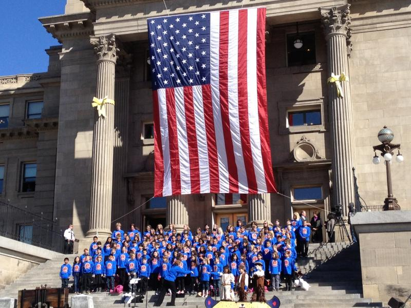 Students from Horizon Elementary sang on the steps the Statehouse to kick off the event.