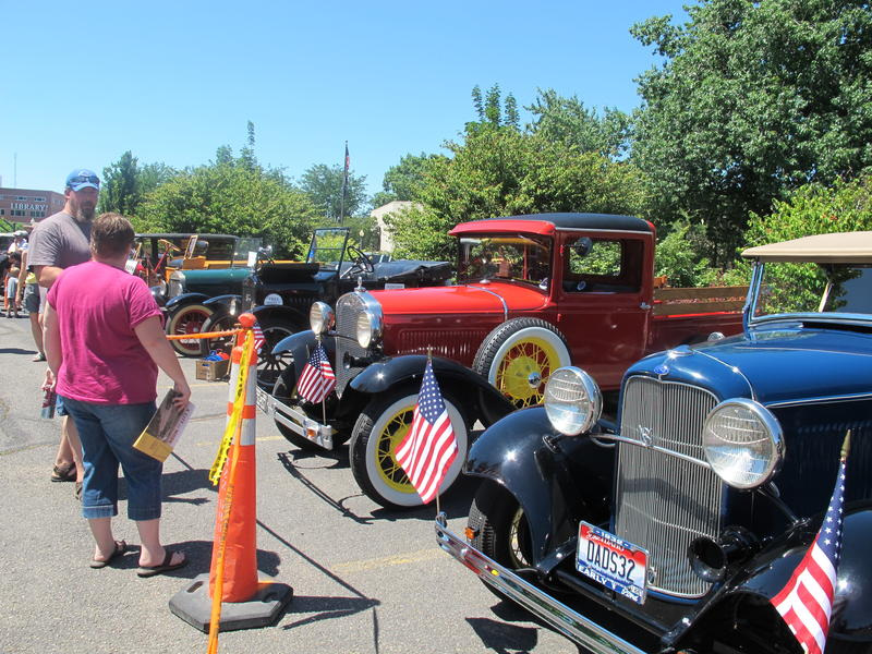 Vintage cars line the street behind the Boise Art Museum.