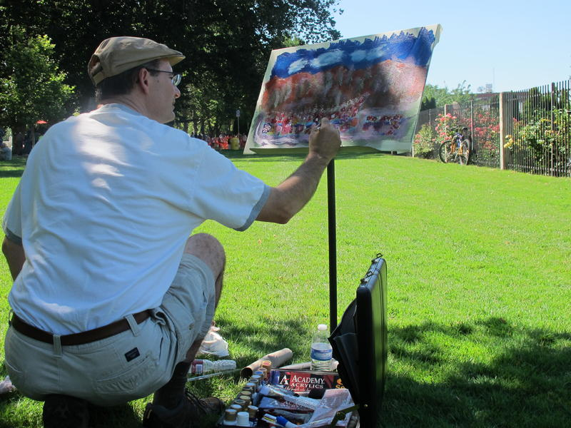 A painter adds color to his canvas at the Rose Garden while people gathered to celebrate Boise's 150 birthday..