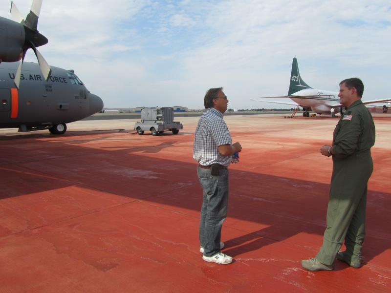 Lt. Col. Kevin Harkey of the North Carolina Air National Guard talks with Canadian pilot Lyle Ehalt on the retardant-stained tarmac at the Boise airport.  Both were in Boise last week flying missions over Idaho wildfires.